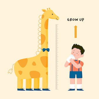 Il ragazzino beve il latte e misura l'altezza con il grafico dell'altezza della giraffa
