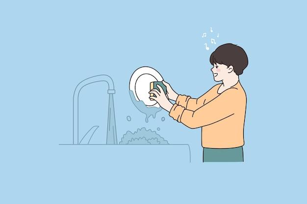 L'aiutante del ragazzino lava i piatti a casa