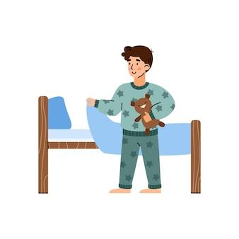 Ragazzino in pigiama che va a dormire fumetto illustrazione vettoriale isolato