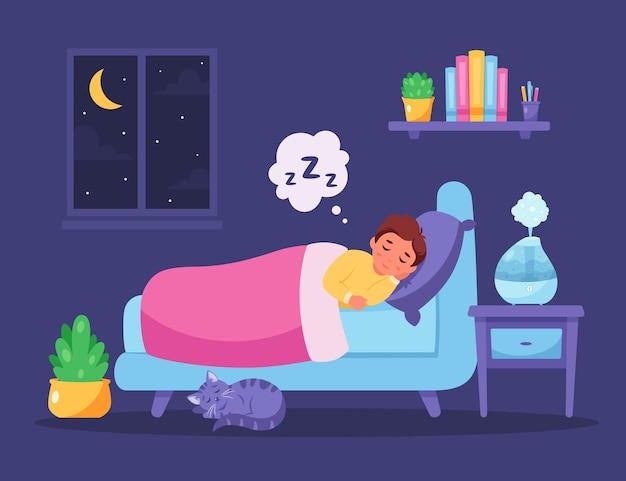 Ragazzino che dorme in camera da letto con umidificatore d'aria sonno sano