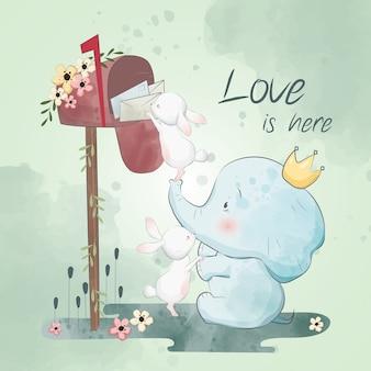Il piccolo coniglietto e l'elefante stanno prendendo le lettere