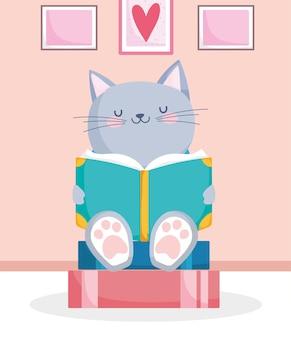 Piccolo gatto con un libro