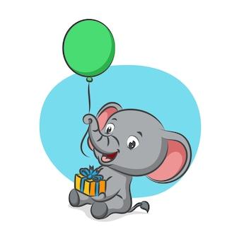 Piccolo elefante che tiene palloncino con la sua proboscide e che tiene un regalo