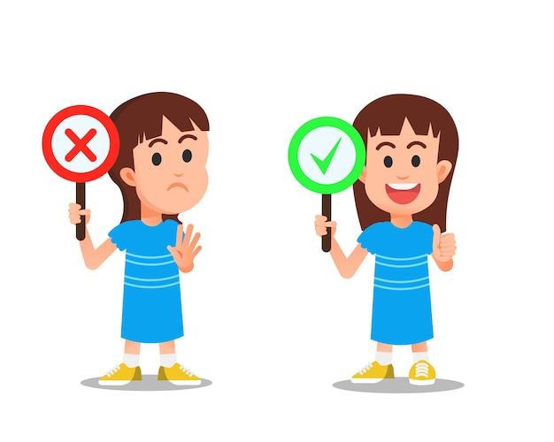 Bambina che tiene i segni corretti e sbagliati