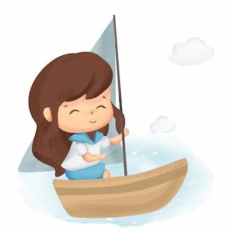 Bambina che libera la barca a vela