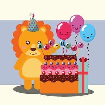 Piccolo leone che celebra il regalo dei palloni della torta