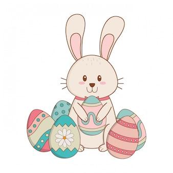 Piccolo coniglio con uova dipinte carattere di pasqua
