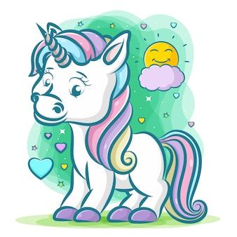 Piccolo unicorno con i capelli arcobaleno con corno grigio su sfondo verde