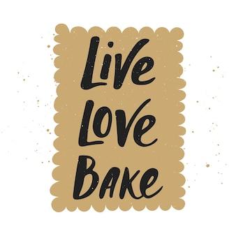 Cuocere l'amore vivo con la calligrafia moderna di lettere scritte a mano di biscotti