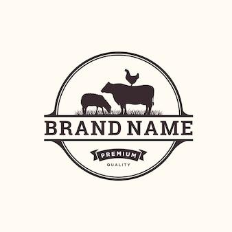Concetto di logo vintage di bestiame con elemento di mucca