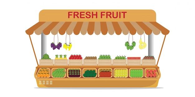 Negozio di frutta del mercato agricolo locale con frutta fresca in scatola di legno.