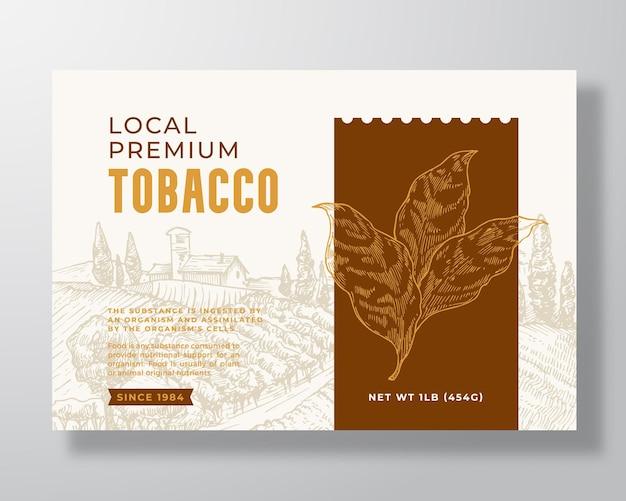 Modello di etichetta per tabacco premium locale. disposizione di disegno di imballaggio di vettore astratto. banner di tipografia moderna con ramo di foglie disegnate a mano e sfondo di paesaggio rurale. isolato.