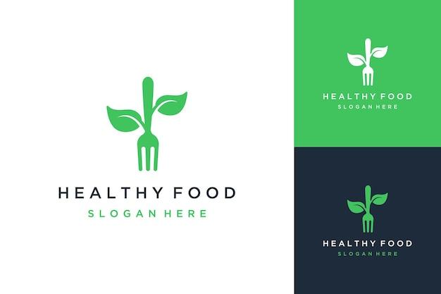 Logo design cibo sano o forchetta con foglie