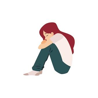 La donna sola si siede sul pavimento che soffre di depressione o rottura del rapporto. concetto di ragazza depressa isolato su priorità bassa bianca.