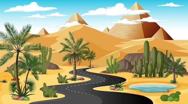 Lunga strada attraverso il paesaggio della foresta desertica nella scena diurna con la piramide di giza