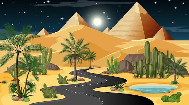 Lunga strada attraverso il paesaggio della foresta del deserto alla scena notturna con la piramide di giza