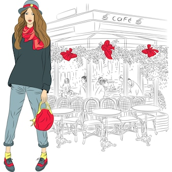 Bella ragazza di moda in stile schizzo sullo sfondo del caffè parigino