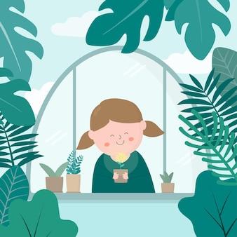 Bella ragazza sorriso all'interno del giardino botanico circondato da varie piante