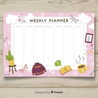 Modello di pianificazione settimanale disegnato a mano incantevole Vettore Premium