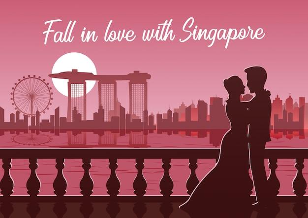 Abbraccio dell'amante insieme vicino del punto di riferimento famoso di singapore