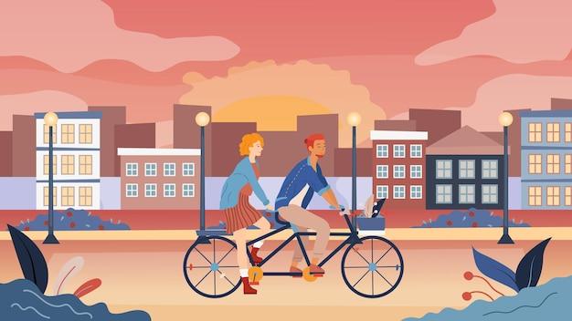 Coppia di innamorati divertirsi, andare in bicicletta in tandem insieme nel parco con vista sul paesaggio urbano.