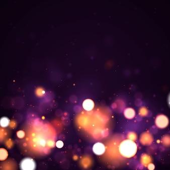 Sfondo luminoso con bokeh di luci colorate dorate