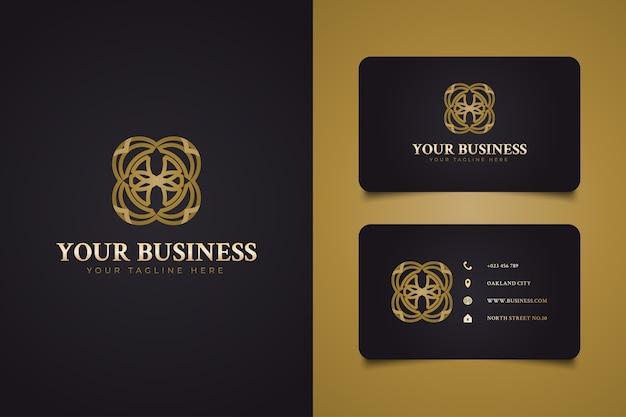 Lussuoso logo rotondo astratto con forma di fiore nel concetto di stile della linea d'oro, adatto per resort, hotel, spa o logo di bellezza