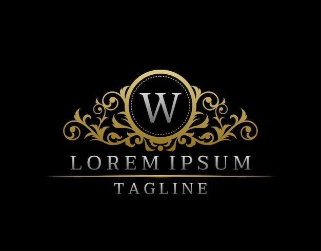 Boutique di lusso lettera w monogram logo, distintivo dorato vintage con elegante design floreale.