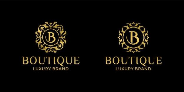 Logo di boutique di lusso con ispirazione del modello di ornamento di design iniziale