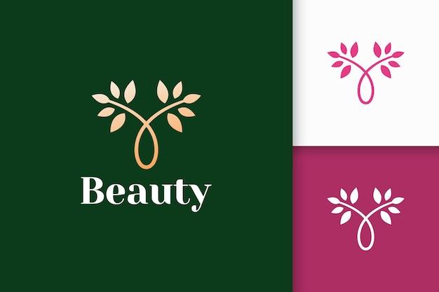 Logo floreale di lusso dalla combinazione di pianta e porto per la cura della bellezza