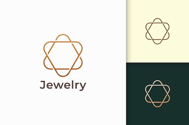 Il logo del gioiello in oro di lusso a forma di linea rappresenta espansivo e prezioso Vettore Premium