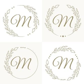 Lettera di lusso m logo design con modello di sfondo cornice floreale