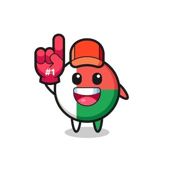 Fumetto dell'illustrazione del distintivo della bandiera del madagascar con il guanto dei fan numero 1, design carino