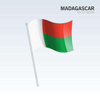 Madagascar sventolando bandiera isolata su gray