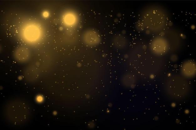 Magico concetto d'oro. astratto sfondo nero con effetto bokeh.