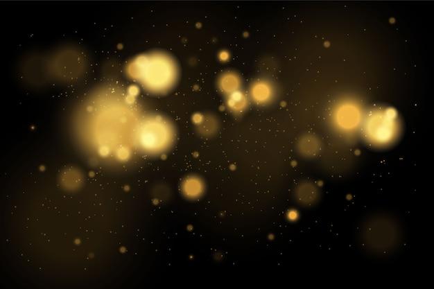 Concetto dorato magico. fondo nero astratto con effetto bokeh.