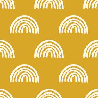 Modello senza cuciture magico con arcobaleno moderno. illustrazione disegnata a mano di arcobaleni di vivaio boho su sfondo giallo. stampa per carta, tessuto, vestiti per bambini e neonati, carta da imballaggio digitale, carta da parati.