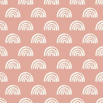Modello senza cuciture magico con arcobaleni moderni. illustrazione disegnata a mano dell'arcobaleno della scuola materna di boho su fondo rosa. stampa per carta, tessuto, vestiti per bambini e neonati, carta da imballaggio digitale, carta da parati.