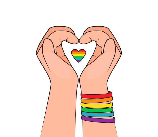 Fare il cuore con le mani piccolo cuore con uno sfondo di bandiera arcobaleno lgbt