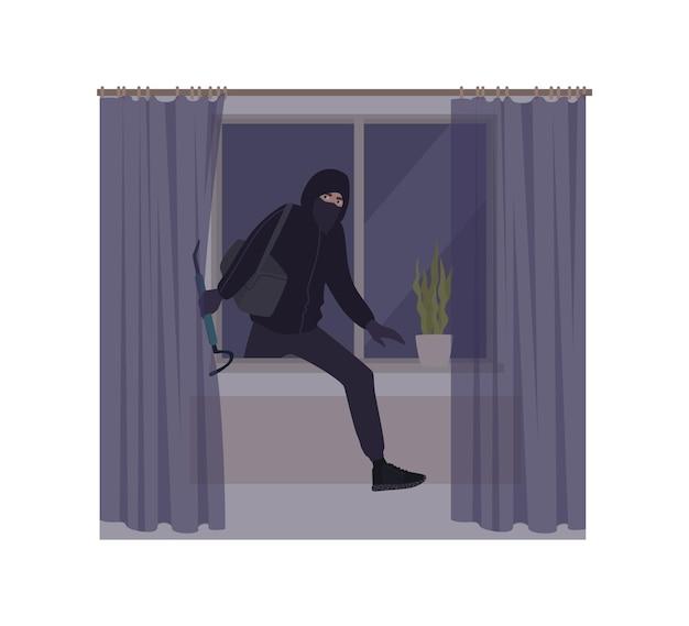 Ladro maschio che indossa maschera e felpa con cappuccio che rompe in casa