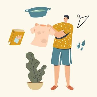 Personaggio maschile che tiene i vestiti con macchie che vanno per il lavaggio o la pulizia.
