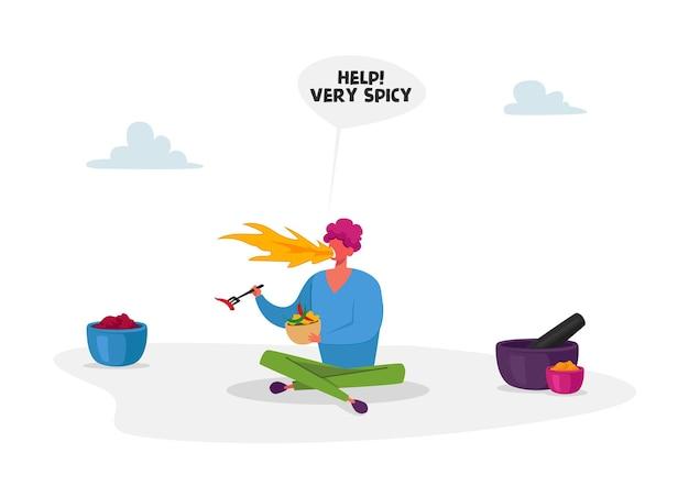 Personaggio maschile con il fuoco in bocca si siede sul pavimento mangiando cibo piccante caldo tenendo in mano la forchetta