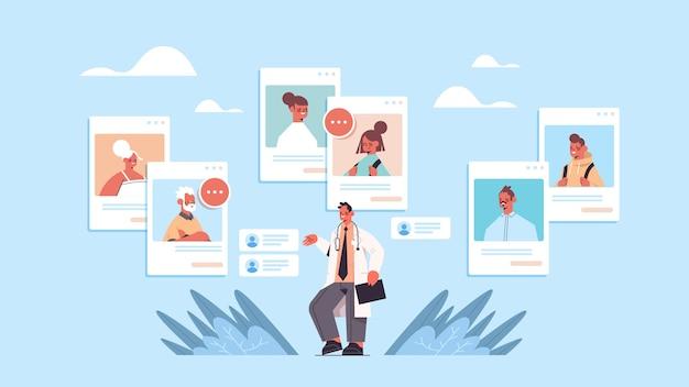 Medico maschio che consulta i pazienti della famiglia nel browser web windows consultazione medica online medicina sanitaria