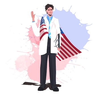 Medico maschio con bandiera usa sventolando la mano festa del lavoro celebrazione