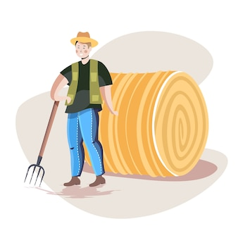 Contadino maschio in uniforme che raccoglie fieno con il concetto di agricoltura agricoltura eco forcone
