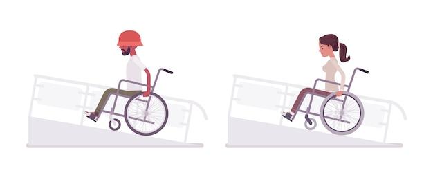 Uomo e donna giovane utente su sedia a rotelle sulla rampa