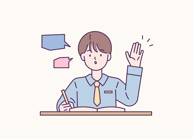 Uno studente alza la mano e fa una domanda in classe