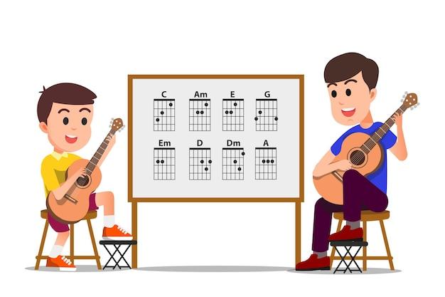 Un insegnante maschio che insegna al suo studente a suonare la chitarra