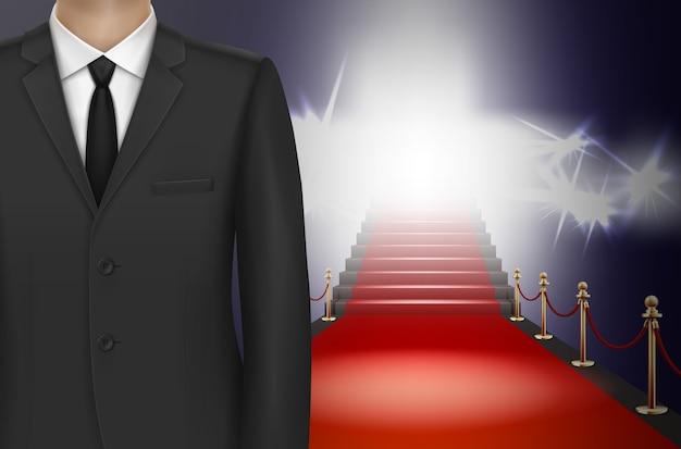 Uomo in abito nero su sfondo tappeto rosso