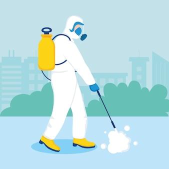 Uomo nel processo di disinfezione della città